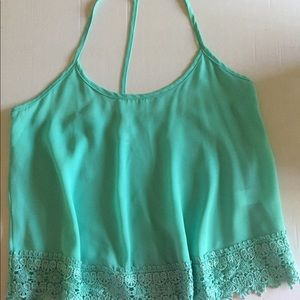 Teal colored tank with detailed bottom